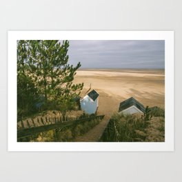 Beach huts and sunlit view out to sea. Wells-next-the-sea, Norfolk, UK Art Print