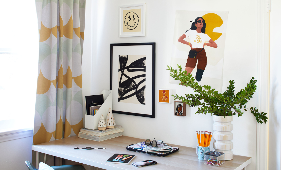 desk with gallery wall above it