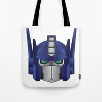 optimus prime Tote Bags featuring Optimus Prime by Tombst0ne