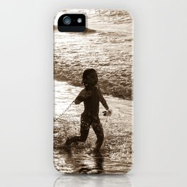 Little surfer girl runs in the waves with her bodyboard iPhone Case