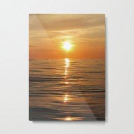 Sun setting over calm waters Metal Print