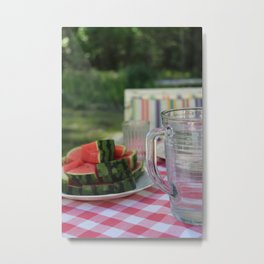 Watermelon and water carafe on garden table Metal Print