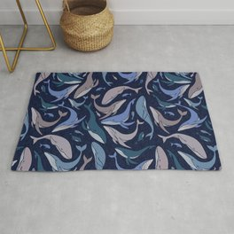 A school of whales Rug