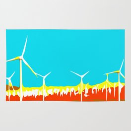 wind turbine in the desert with blue sky Rug