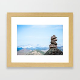 Rocky Mountains with a Cairn in the Foreground Framed Art Print