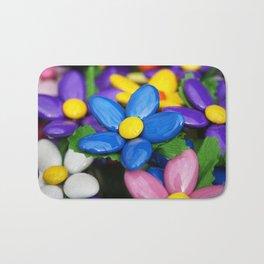 Colored sugared almonds as petals Bath Mat