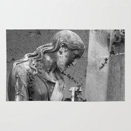 sad female statue Rug