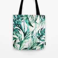 paradise Tote Bags featuring Green Tropical paradise  by Nikkistrange