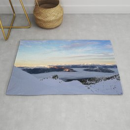 Morning light sweeping mountain peaks above sea of clouds Rug