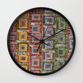 Many ornamented Frames put in vertical Rows Wall Clock