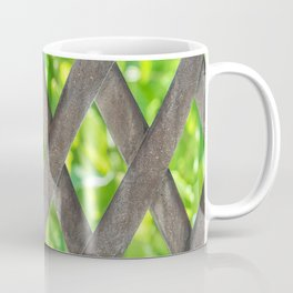 Metal material fence with green leafs at the background Coffee Mug
