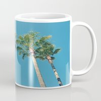 palm tree Mugs featuring Palm tree by Laura James Cook