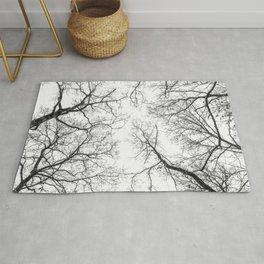 Black branches, white sky Rug