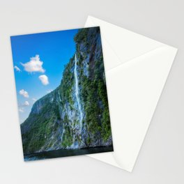 One of the numerous waterfalls falling down the sheer cliffs at Milford Sound. Stationery Cards
