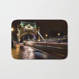 Night shot of traffic light trails on Tower Bridge London Bath Mat