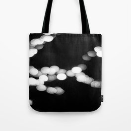 light almost reaches Tote Bag