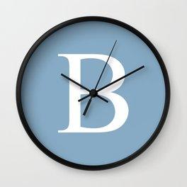 Letter B sign on placid blue color background Wall Clock