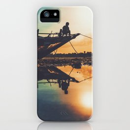 Kid sitting on a boat during the sunset iPhone Case