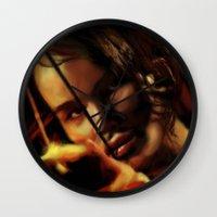 katniss Wall Clocks featuring Katniss by tgronberg