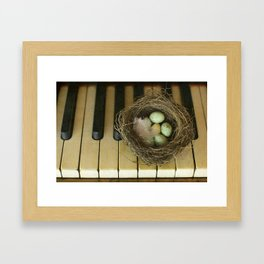 Chocolate Eggs in a Birds Nest on a Vintage Piano. Framed Art Print