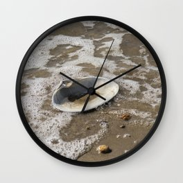 Clam shell against the tide Wall Clock