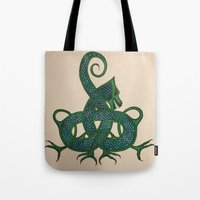celtic Tote Bags featuring Celtic Dragon by Erin Malbuisson-Delaney