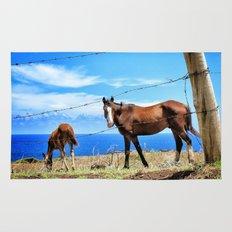 Horses against a blue sky Rug