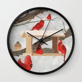 Cardinals at bird feeder Wall Clock