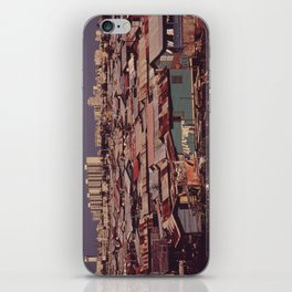 'MODERN BUILDINGS TOWER OVER THE SHANTIES CROWDED ALONG THE MARTIN PENA CANAL' iPhone Skin