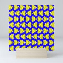 Yellow striped hearts on a blue background. Mini Art Print