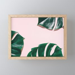 Green monstera leaves on pink ink Framed Mini Art Print