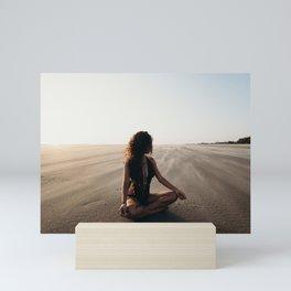 WOMAN - SITTING - ON - SAND - PHOTOGRAPHY Mini Art Print
