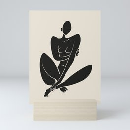 Sitting nude in black Mini Art Print