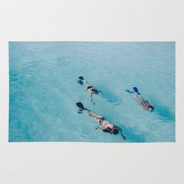 swimming in ocean Rug