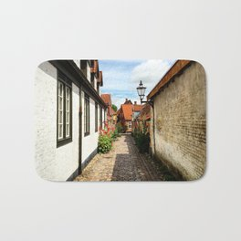 Narrow streets of Ribe Bath Mat