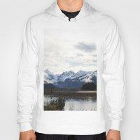 alaska Hoodies featuring Alaska by Chris Root