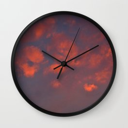 Red clouds shining at sunset Wall Clock