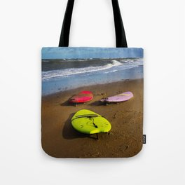 Surfing boards on beach Tote Bag