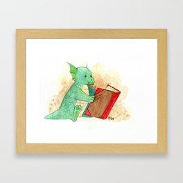 Reading baby dragon Framed Art Print