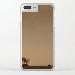 Lone wildebeest grazing in South Africa at sunset Clear iPhone Case