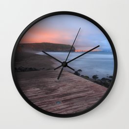Beach at sunset Wall Clock