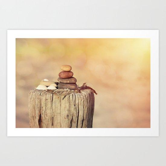 Balanced stone cairn in sunset light Art Print