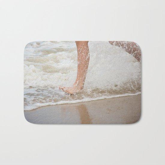 Running on the beach Bath Mat