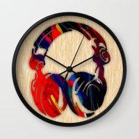 headphones Wall Clocks featuring Headphones by marvinblaine