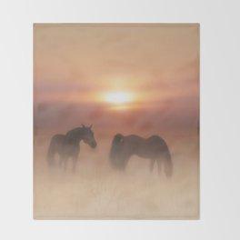 Horses in a misty dawn Throw Blanket