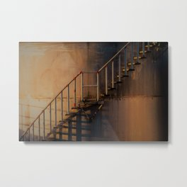 Metal stairs outside an industrial silo at sunset Metal Print