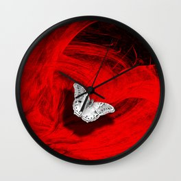 Silver butterfly emerging from the red depths Wall Clock