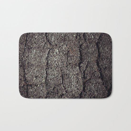 Cracked asphalt road Bath Mat