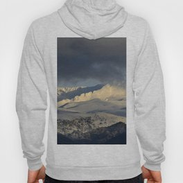 Snowy mountains through the clouds. Hoody