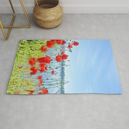 Red poppies in the lakeshore Rug
